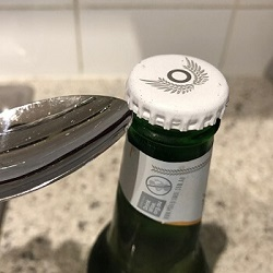 Remove a Bottle Cap Without an Opener 2
